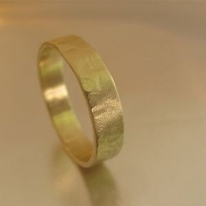 Gold wedding ring for man.